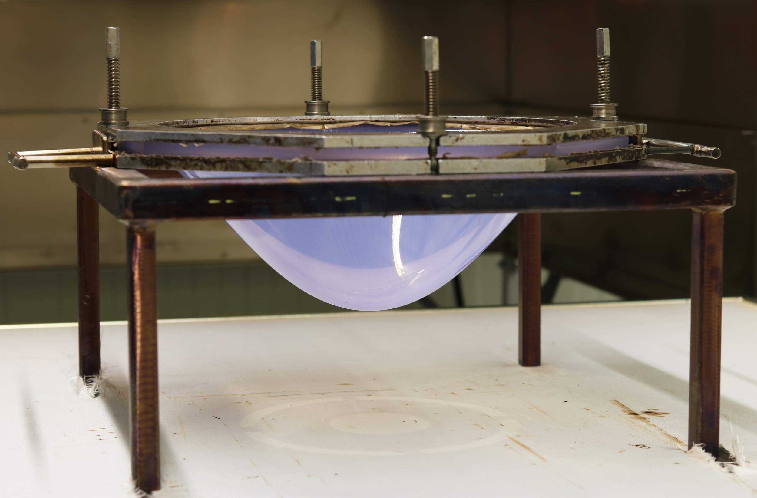 Bubble formed thermoplastic sheet for the creation of prosthetic sockets in a supporting frame
