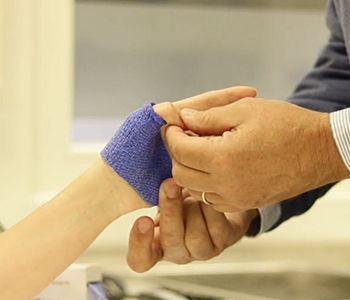 Checking the fit of a thumb immobilization orthosis in Orficast blue.