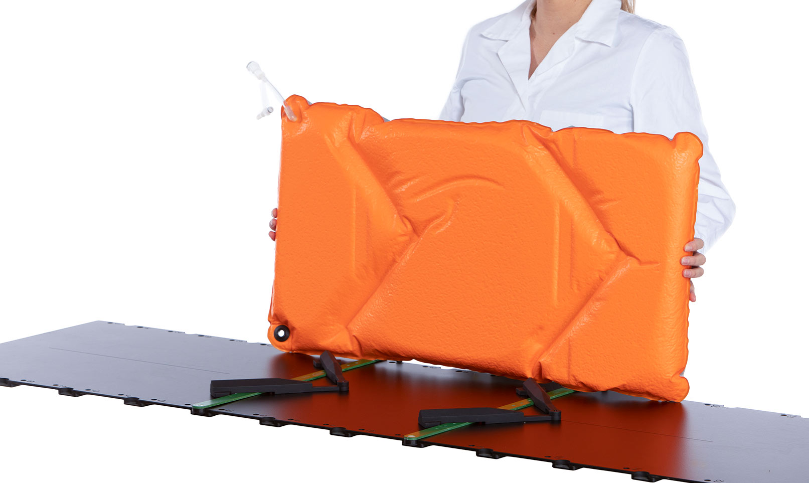 Woman holding an Orange Orfit Vacuum Bag over a couchtop with two indexing bars.