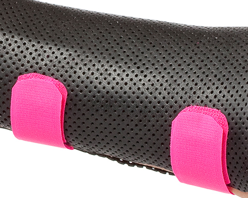Black orthosis with pink hook-and-loop strapping