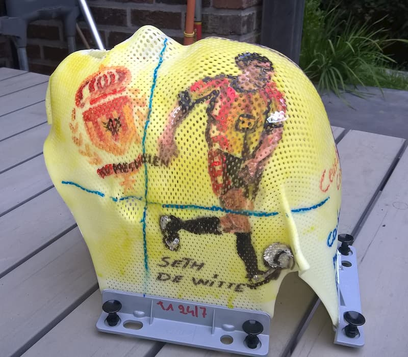 Soccer-themed decoration of pediatric immobilization masks