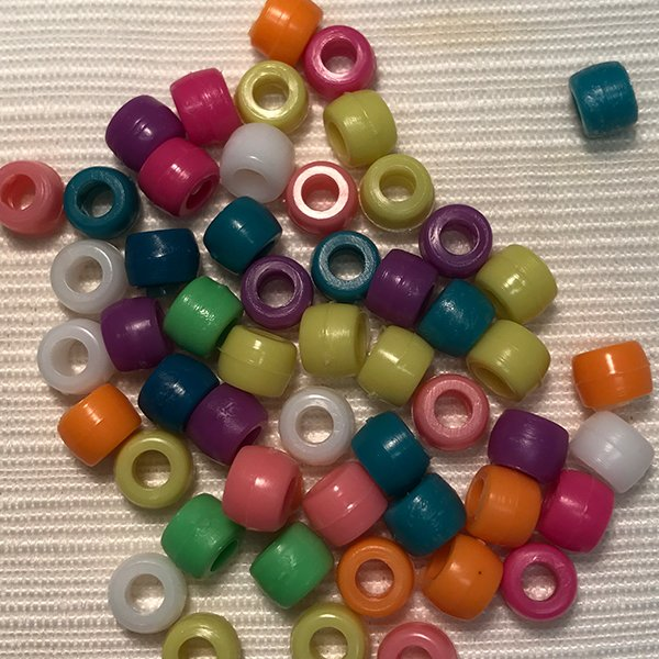 Colorful beads for the decoration of an orthosis